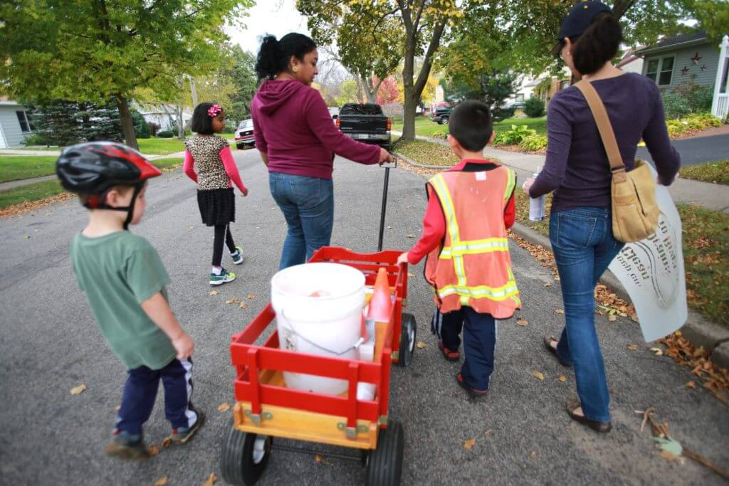 Como Park neighbors work together to solve problems, such as leaf-raking to improve water quality in nearby Como Lake..