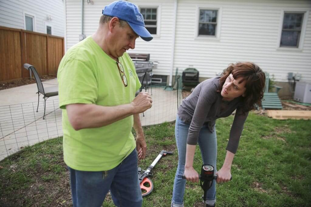 Berg and Dahm experiment with a soil penetrometer before tackling next steps in organic lawn care.