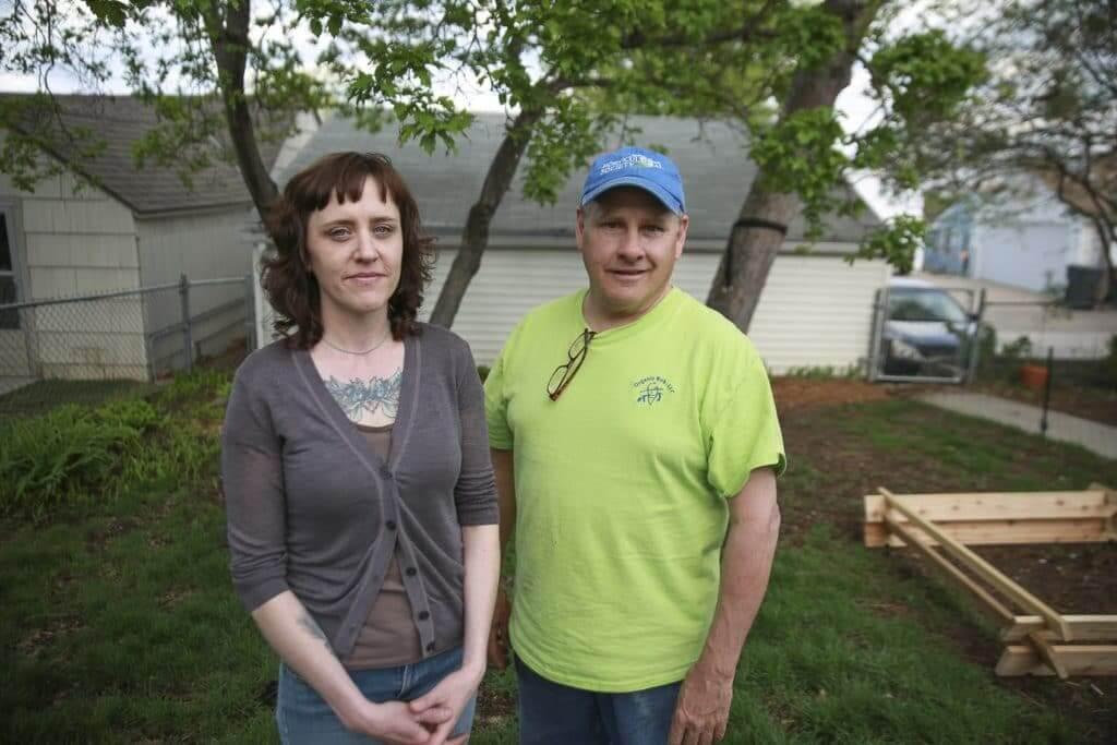 Business partners Berg and Dahm begin DIY process for organic lawn care in Berg's south Minneapolis backyard.