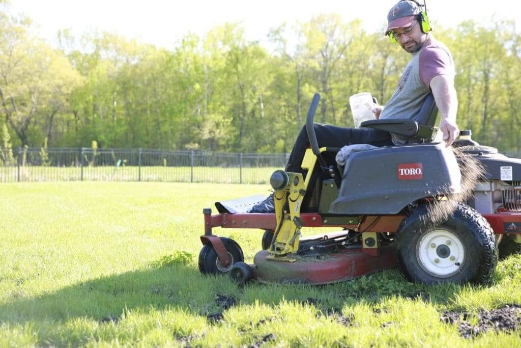 Sam Tabaka uses organic lawn care practices to reseed lawn following vole activity.
