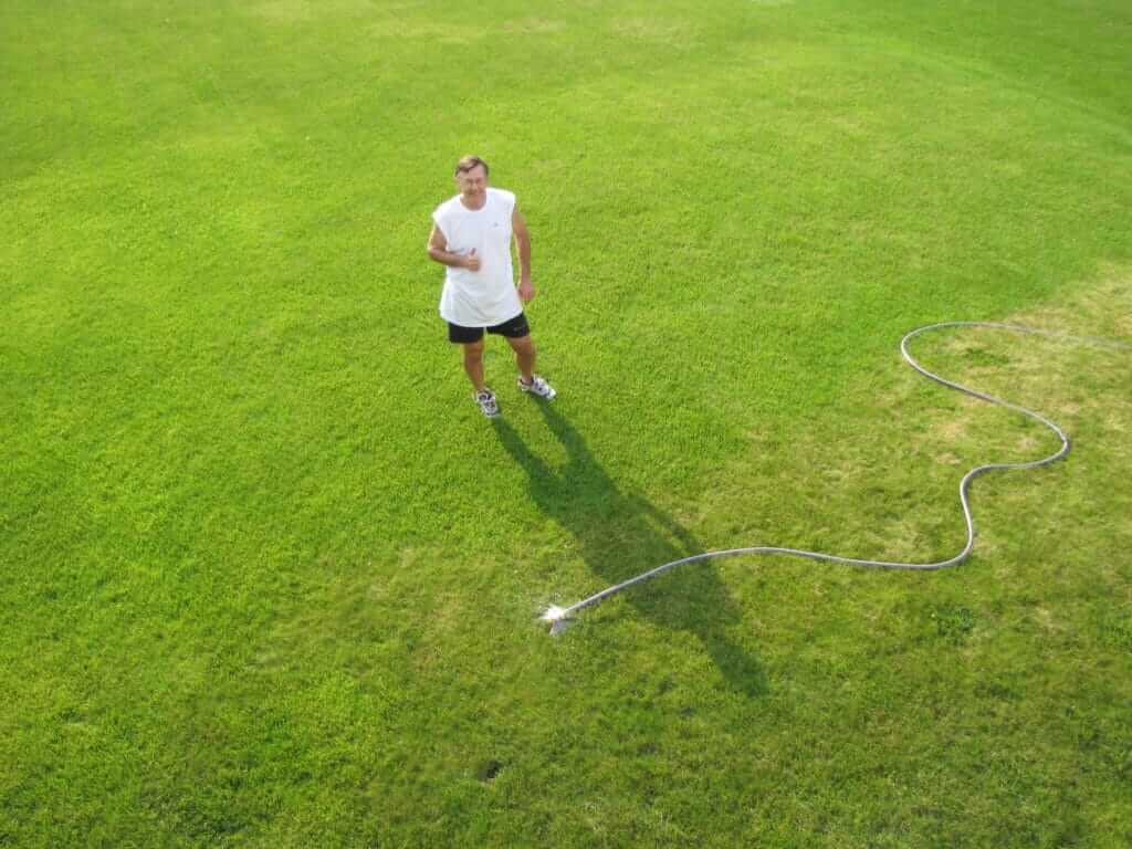 Rain barrel water helps keep Woodbury yard green.