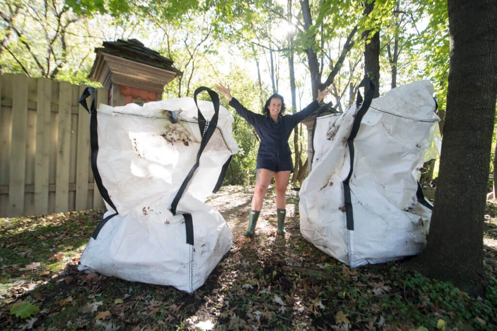 Williams holds fabric bins awaiting pick up from a national recycling program, part of a water quality improvement plan to clean up American rivers.